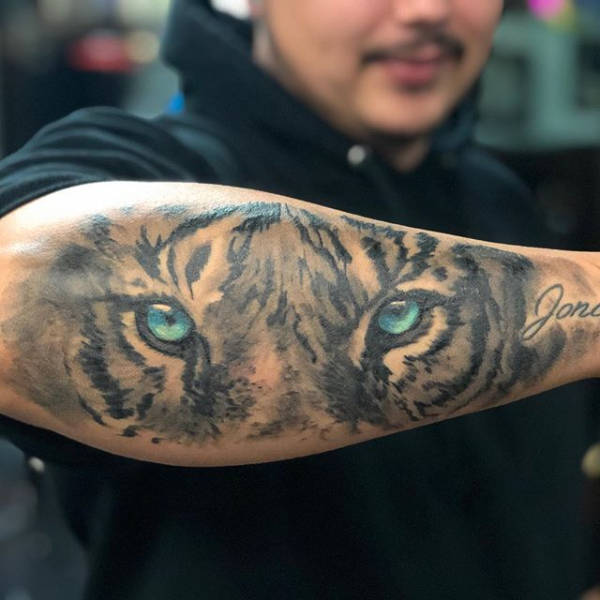 An arm with a tiger tattoo